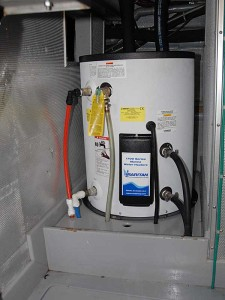 The new 20 gallon, 240 volt hot water heater, installed and working!
