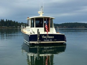 Yes Please, new boat name, is applied to transom.