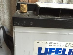 Replacing the Generator Start Battery.  Notice the date code from 2005!