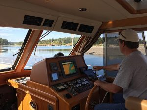 Captain Boyd negotiating the shallow entrance to Fisherman Bay, Lopez Island.